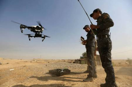 a-member-of-iraqi-forces-operates-an-unmanned-drone-to-make-it-fly-over-islamic-state-position-outside-the-town-of-safayah-near-mosul-iraq-october-23-20